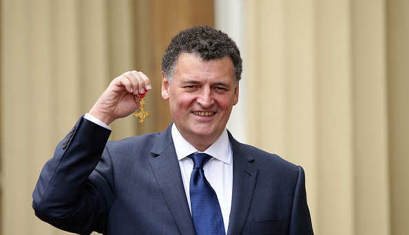 LONDON, UNITED KINGDOM - FEBRUARY 4: Screenwriter Steven Moffat poses at Buckingham Palace, after being made an OBE (Officer of the Order of the British Empire) for his services to drama by the Prince of Wales on February 4, 2016 in London, England. (Photo by Yui Mok - WPA Pool /Getty Images)
