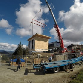 A crane puts the building in place.
