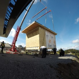 Building is set on its foundations and electrical ducts are put in place.