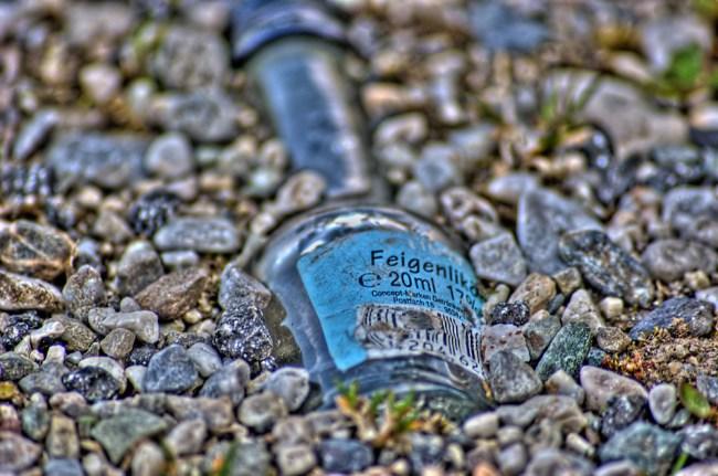 Stoned bottle in sand