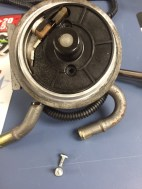 Remove the (2) T20 Torx bit screws from the center of the fuel filter head to access the spring and check ball