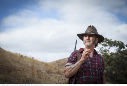 WolfCreek2_John Jarratt as Mick Taylor_ with gun _ from below 2