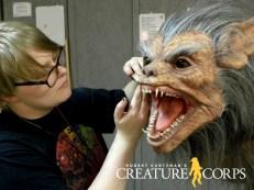 Tate Mclellan-Bolen lays hair on attack puppet head