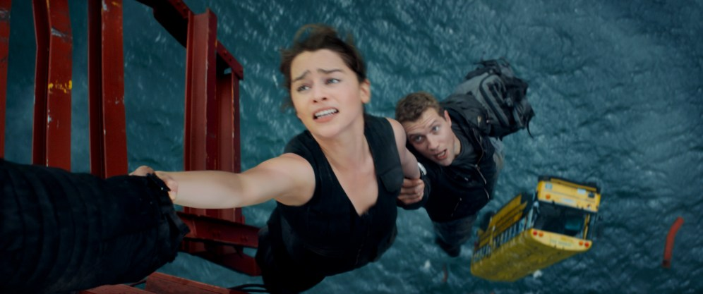 Left to right: Emilia Clarke plays Sarah Connor and Jai Courtney plays Kyle Reese in TERMINATOR GENISYS from Paramount Pictures and Skydance Productions.