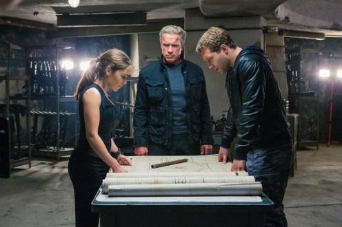 Left to right: Emilia Clarke plays Sarah Connor, Arnold Schwarzenegger plays the Terminator, and Jai Courtney plays Kyle Reese in Terminator Genisys from Paramount Pictures and Skydance Productions.
