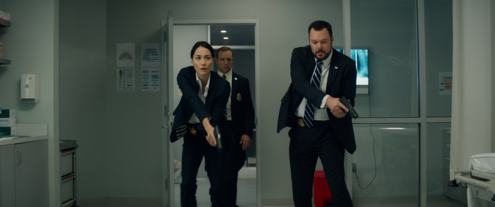 Left to right: Sandrine Holt plays Detective Cheung, Matty Ferraro plays Agent Janssen, and Michael Gladis plays Lieutenant Matias in Terminator Genisys from Paramount Pictures and Skydance Productions.