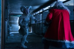 """(L-R): Rob Archer as Krampus and George Buza as Santa in the horror film """"A CHRISTMAS HORROR STORY"""" an RLJ Entertainment release. Photo credit: RLJ Entertainment."""