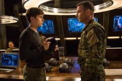 """Nick Robinson and Liev Schrieber in Columbia Pictures' """"The 5th Wave,"""" starring Chloë Grace Moretz."""