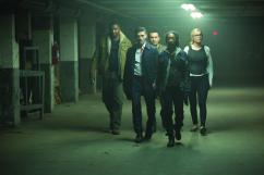 """(left to right) MYKELTI WILLIAMSON as Joe Dixon, FRANK GRILLO as Leo Barnes, JOSEPH JULIAN SORIA as Marcos, BETTY GABRIEL as Laney and ELIZABETH MITCHELL as Senator Roan in Universal Pictures' """"The Purge: Election Year"""" reveals the next terrifying chapter that occurs over 12 hours of annual lawlessness sanctioned by the New Founders of America to keep this country great."""