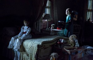 (L-R) The Annabelle doll and TALITHA BATEMAN as Janice in New Line Cinema's supernatural thriller ANNABELLE 2, a Warner Bros. Pictures release.