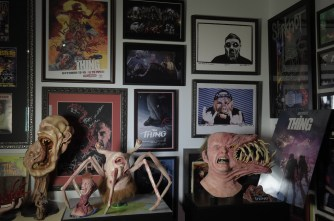 A wall of The Thing miscellaneous collectible memorabilia. From Jeremy Wagner's THE THING Tribute Room