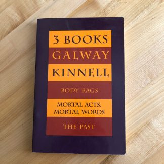 3 Books by Galway Kinnell, lying on a maple tabletop. The dark purple cover features stripes in orange and rust around the titles and author name.