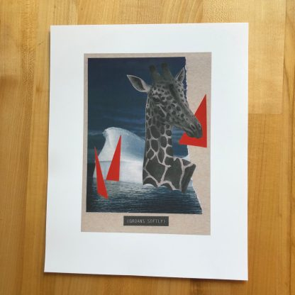 A collage of a black-and-white giraffe swimming in water with some large hot pink triangles and an iceberg. Below the water is a closed-caption style title: (GROANS SOFTLY). The 5 x 7 image is printed on 8 x 10 white paper with a wide border, and the print is lying on a maple tabletop.
