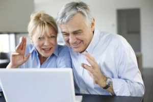 16397524 - senior couple connected with family on internet
