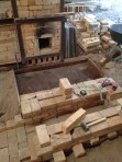 Firebox complete and concrete slab mold framed out.