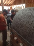 """Scott Parady, Shasta Krueger, and Jillian Blackwell applying the castable over 3"""" of Kaowool and chicken wire"""