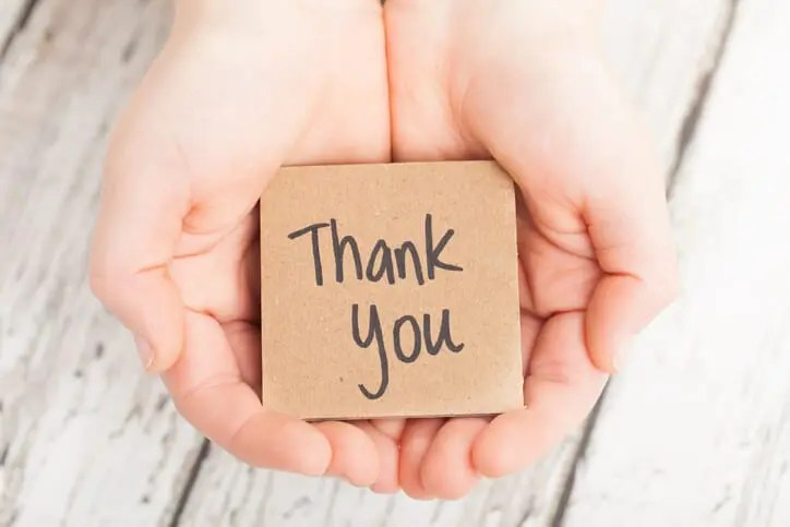 hands holding note to say thank you to your employees