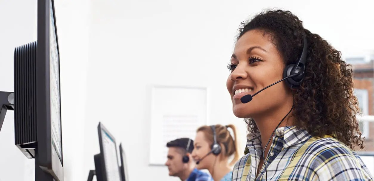 woman with headset demonstrating good customer service skills