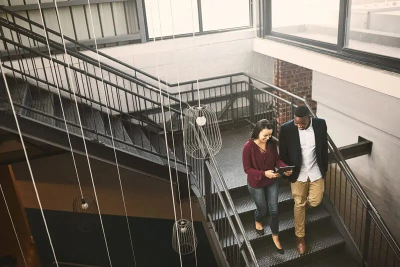 coworkers on stairs building a culture of content