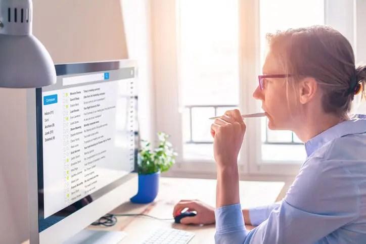businesswoman practicing email inbox management on desktop