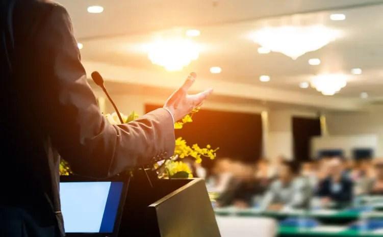 speaker at podium leading corporate training programs