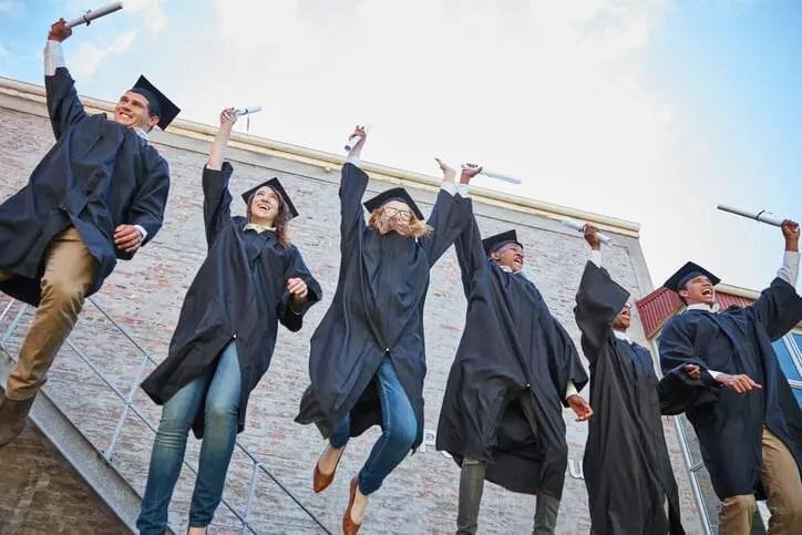 graduates celebrating together after social corporate learning program