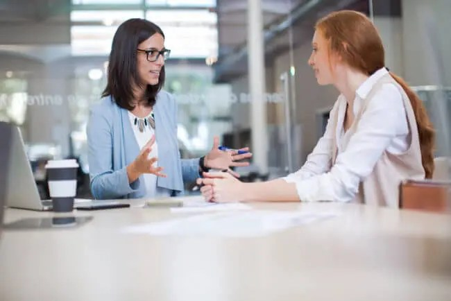 subject matter expert meets with new hire to provide training content
