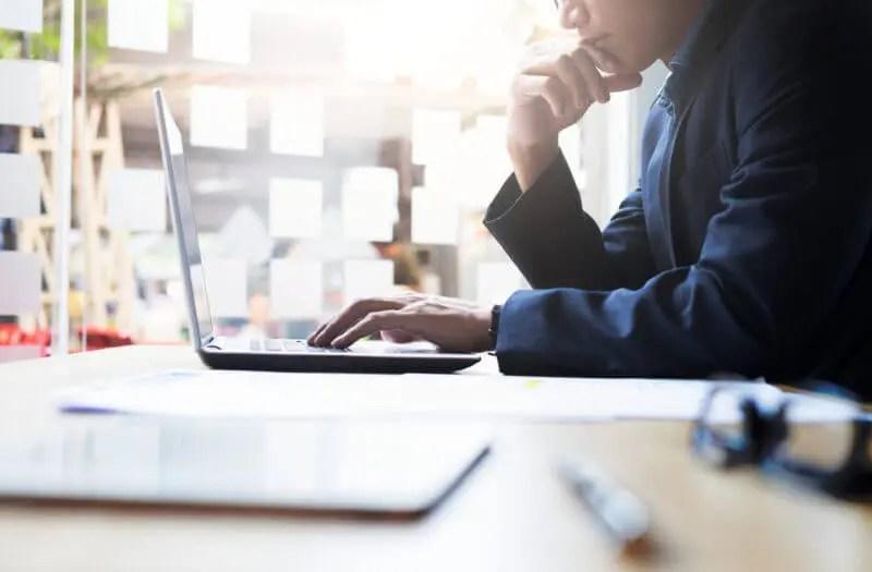 creating an online partner portal concept man on laptop