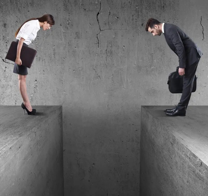 Two business people separated by a large gap in the floor representing silos.
