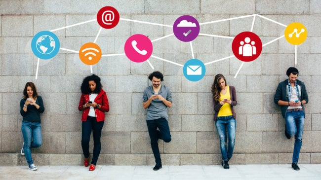 young marketers on phones developing a social media strategy