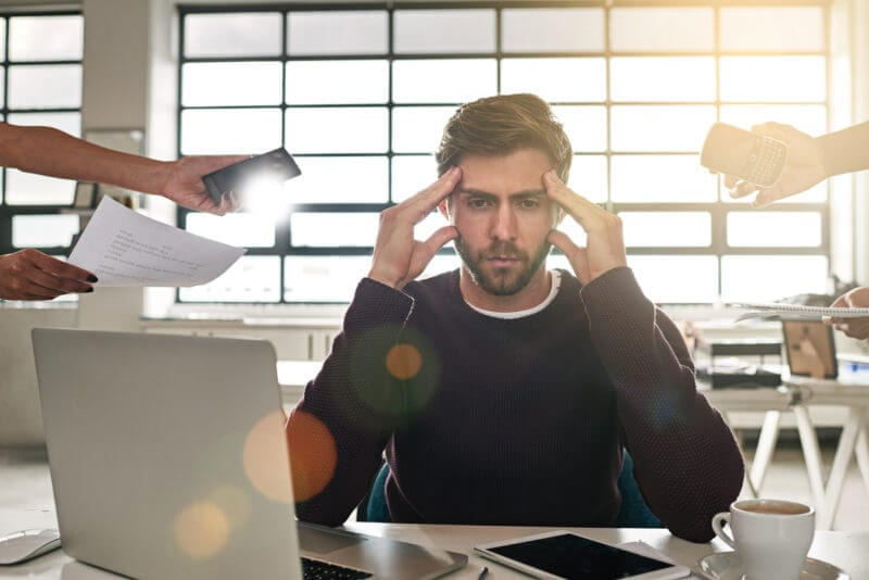 frustrated man reflects on wasted time at work