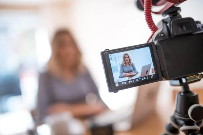 young woman filming video for your business