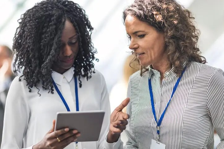 businesswoman at conference providing personalized customer service to client