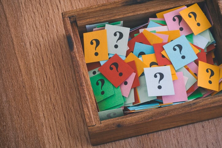question marks in wood box representing knowledge sharing mistakes