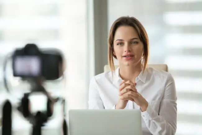 businesswoman recording an ongoing training session in office