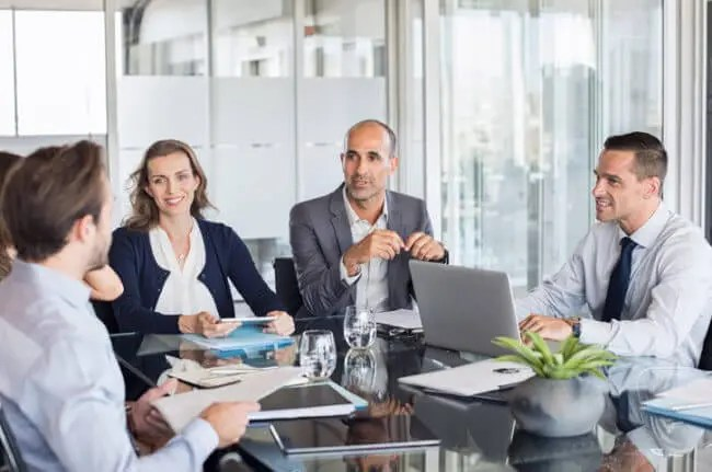 business team meets to dispel change management myths