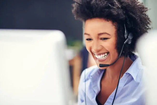 young call center rep smiling after completing customer service training