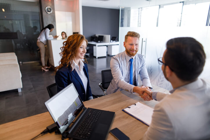 loan officer with couple representing financial services change management