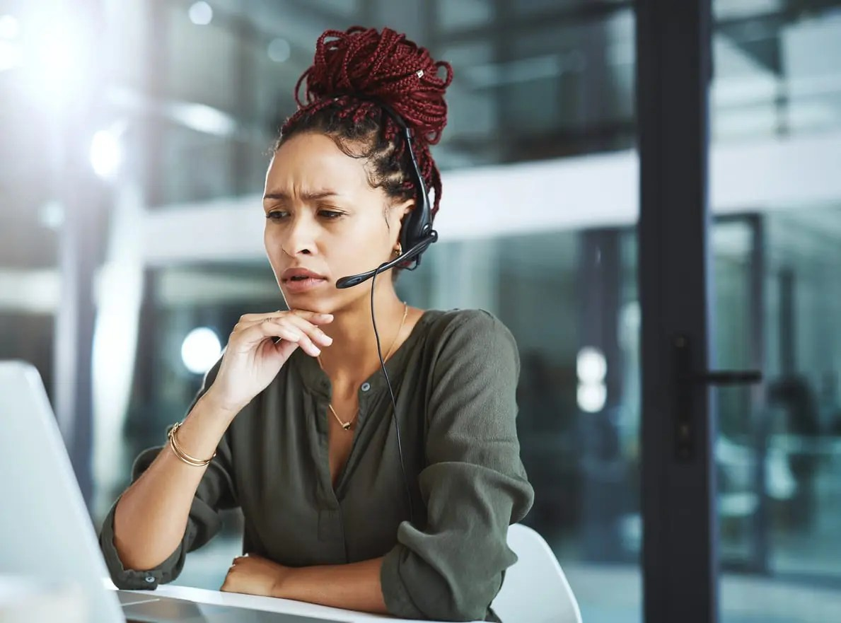 customer service rep working on how to improve the customer experience in your call center