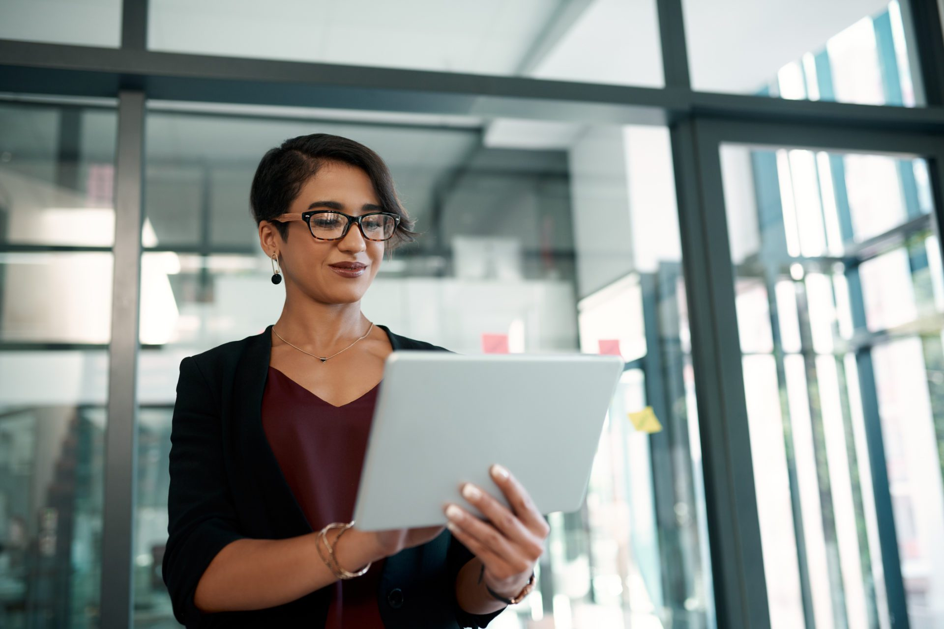 Businesswoman accesses company insights on tablet