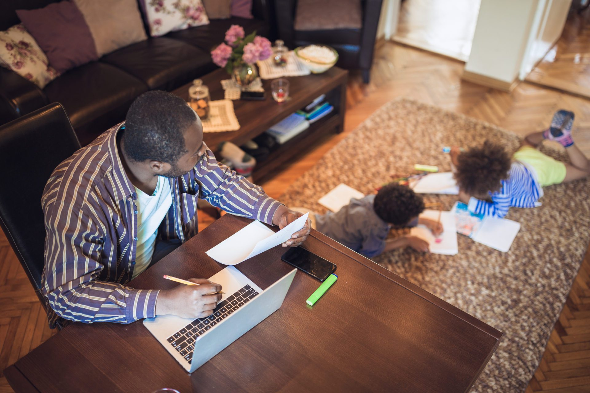 father at home with kids in flexible work environment