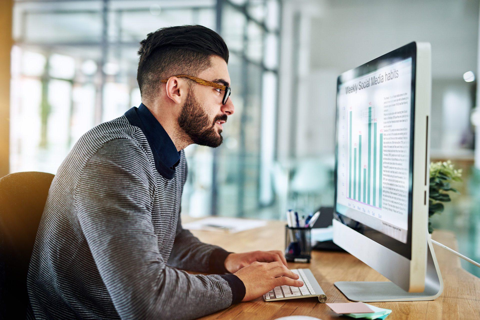 man viewing market research report on desktop exemplifies data-driven culture