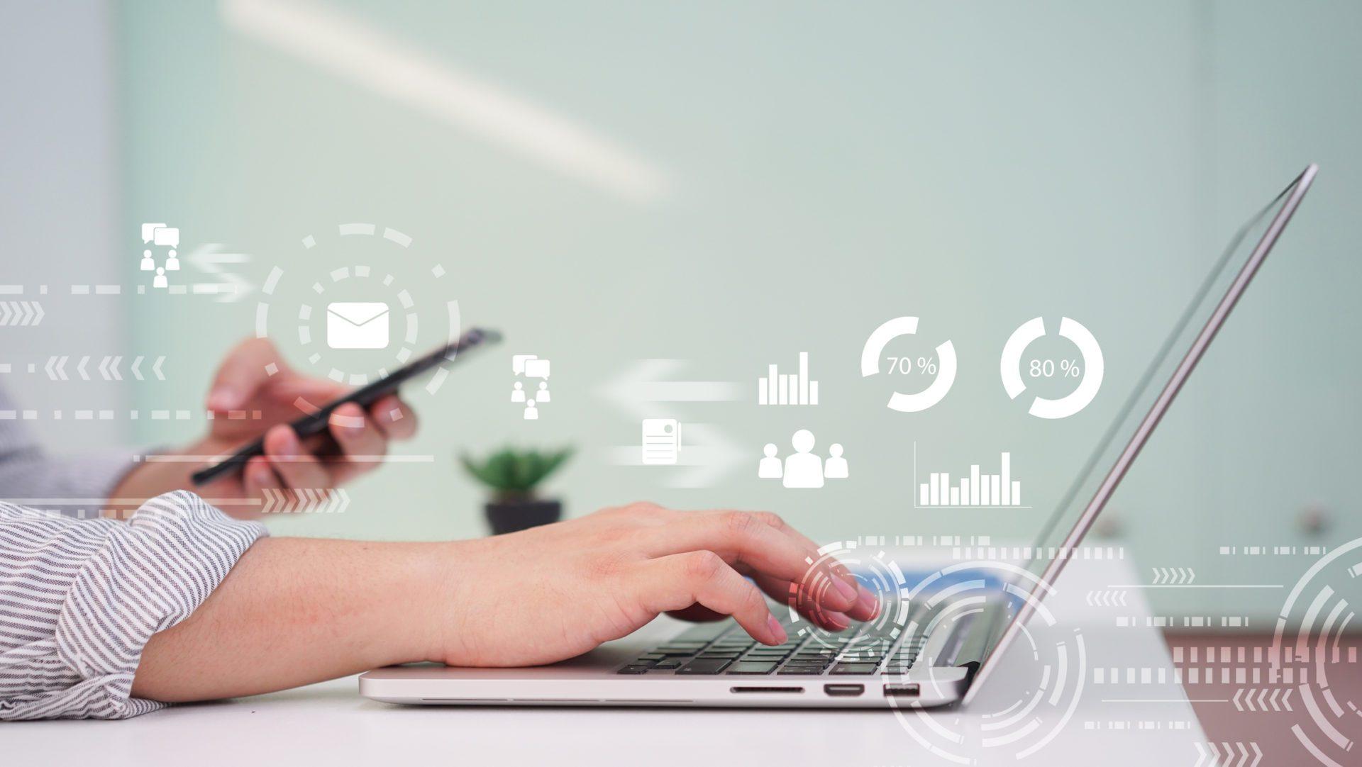 analytics icons over laptop show knowledge management metrics