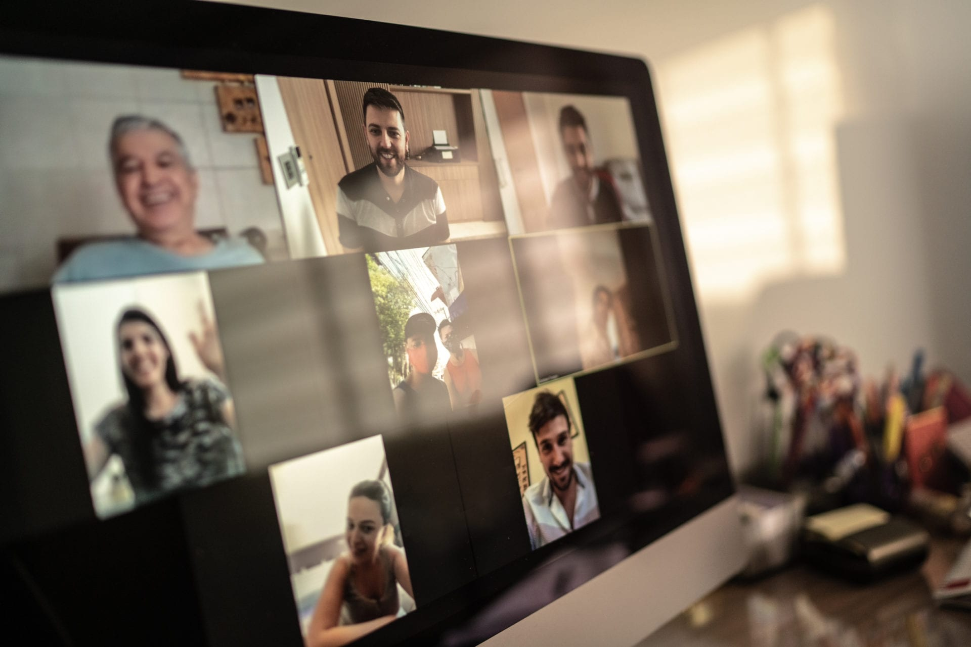 video chat on monitor representing TMRE 2020 virtual conference
