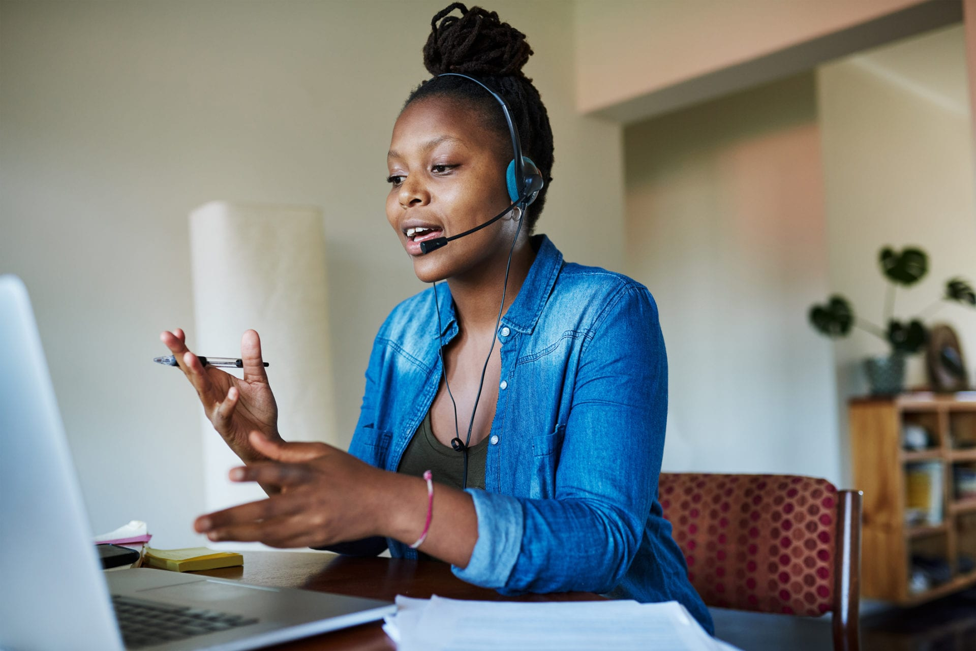 woman wearing headset and working from home is part of remote customer service team