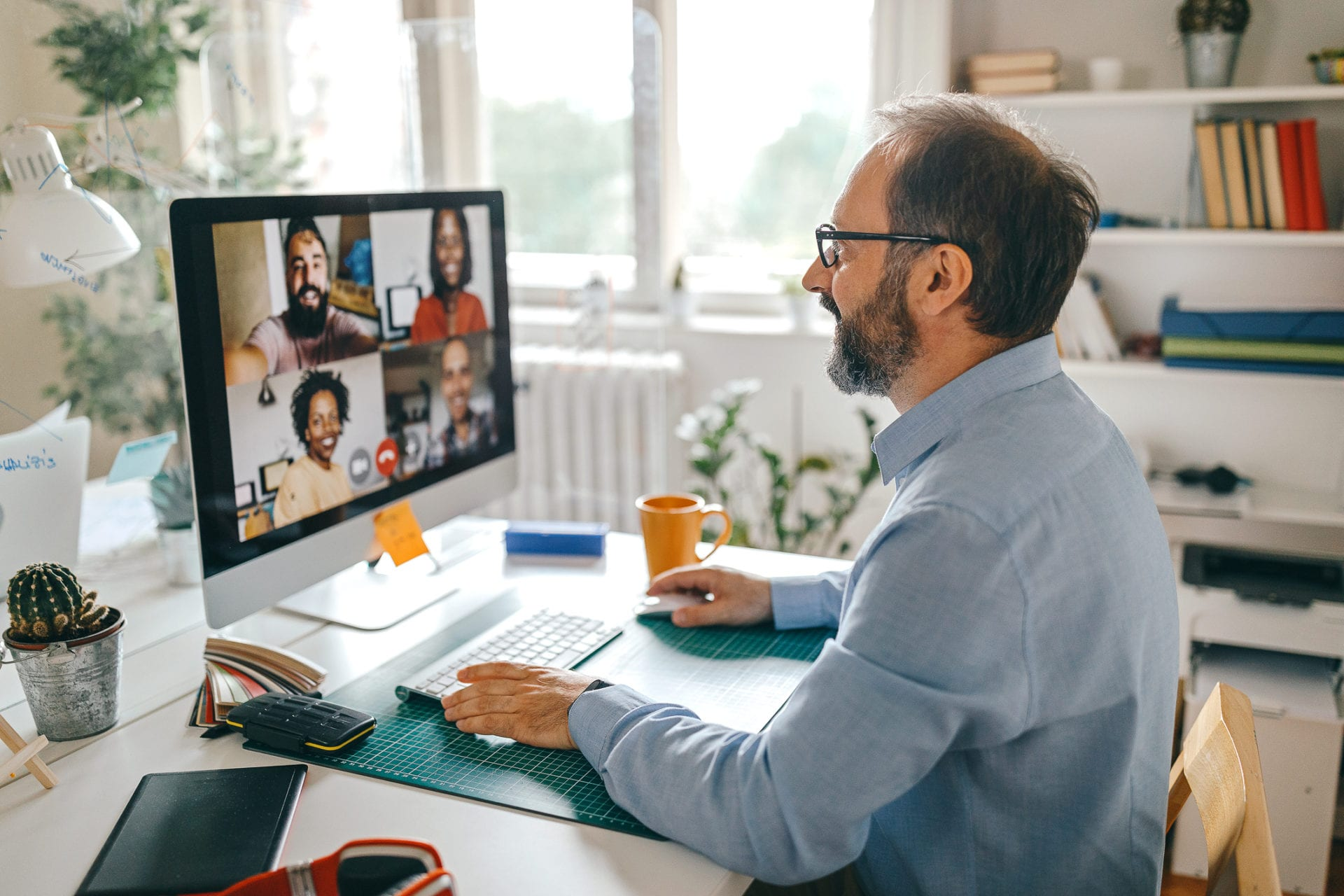 senior leader working to improve workplace communication with virtual team meeting