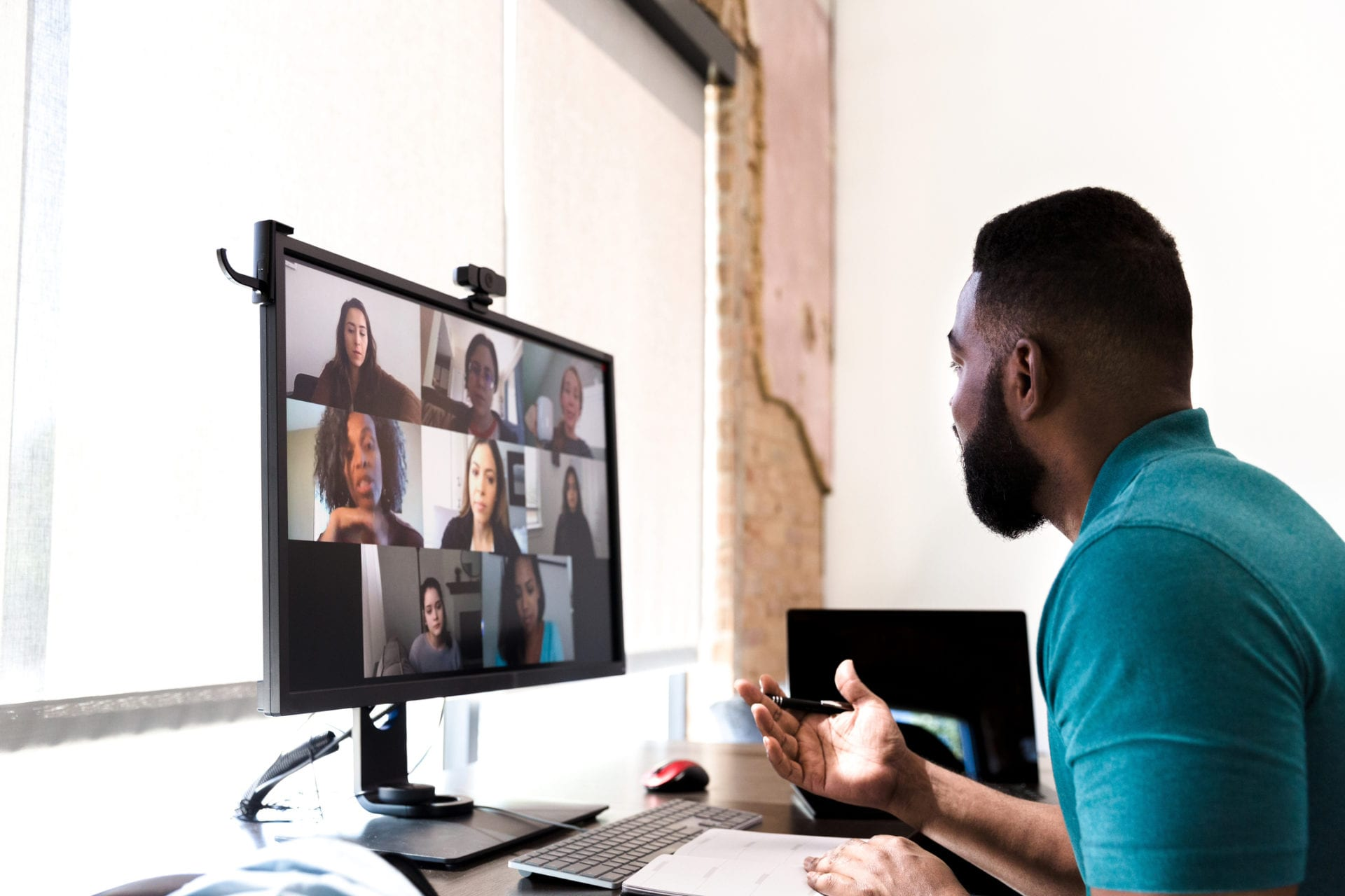 virtual team meeting to stay connected and improve professional services employee experience
