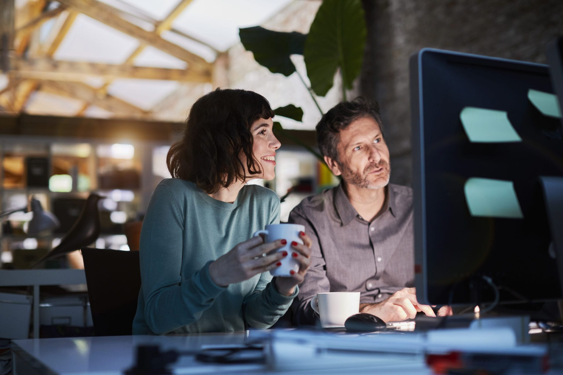 two team members working late at software company need knowledge management strategy