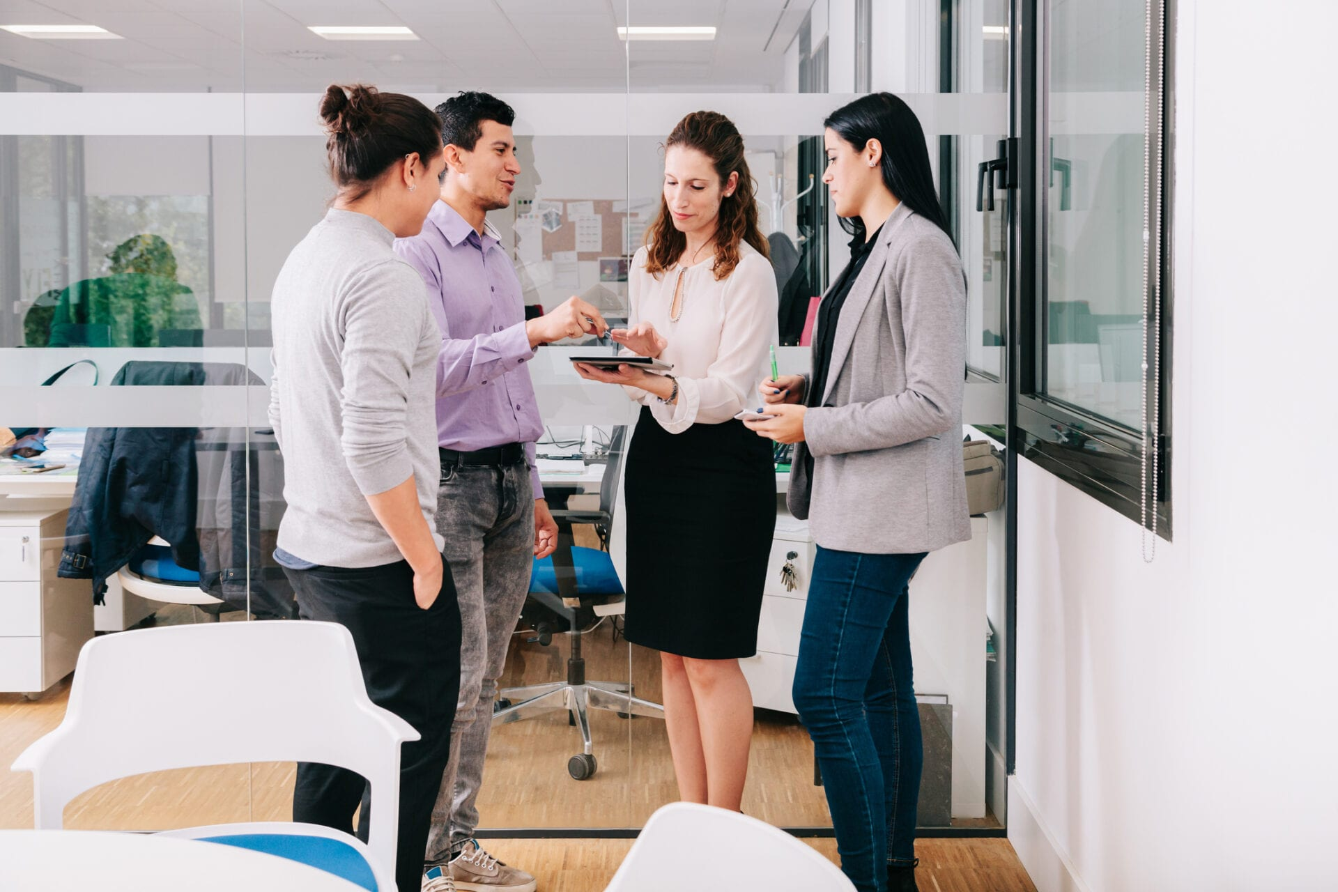 office workers gather in conference room and share implicit knowledge