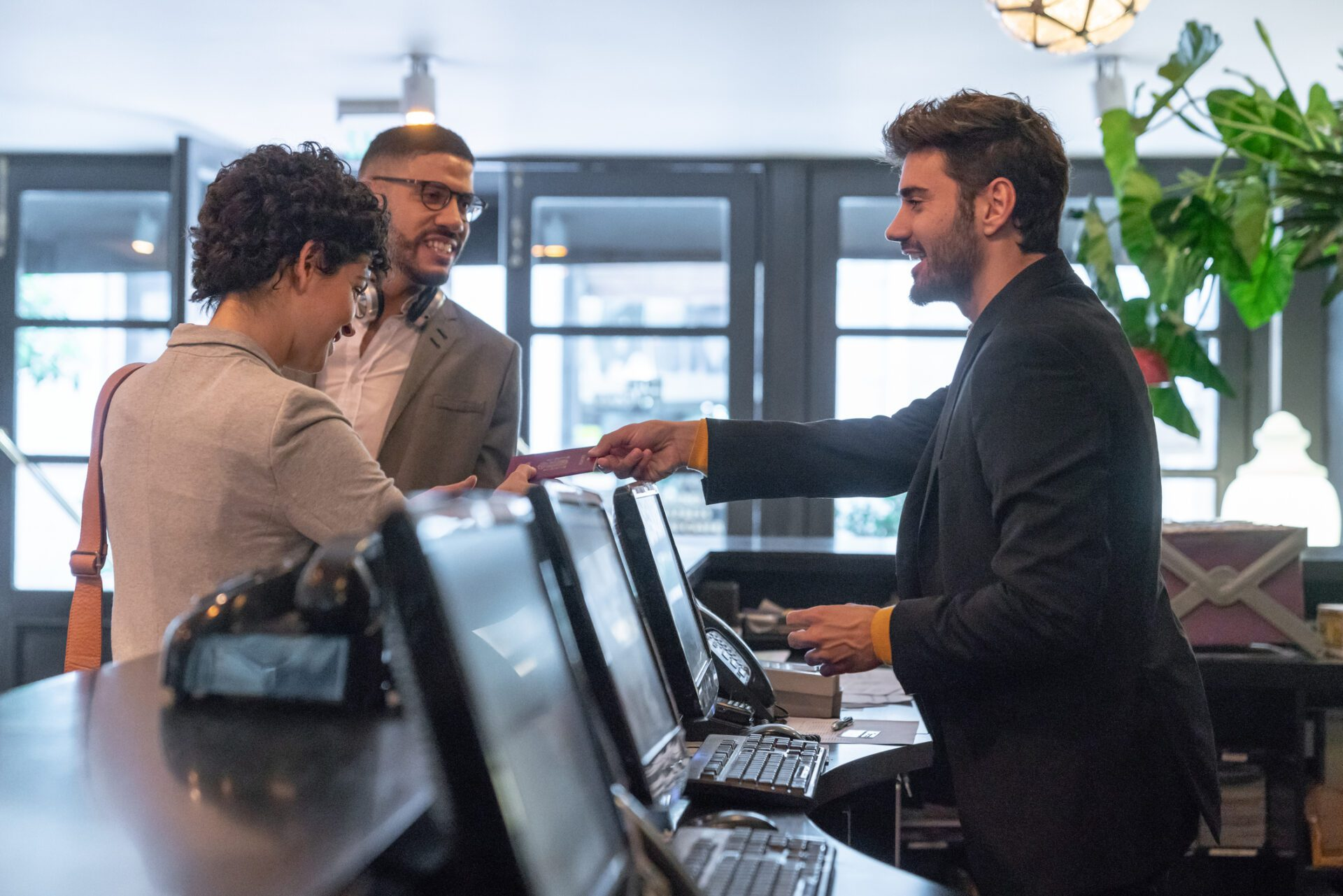 hotel front desk employee demonstrating knowledge management in hospitality industry